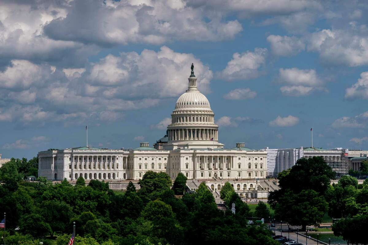FILE - In this June 20, 2019, file photo, the Capitol is seen from the roof of the Canadian Embassy in Washington. Americaa€™s much-maligned health care system is covering more people than ever, a fact lost on many of the 2020 presidential candidates, who keep debating polarizing ideas about how to set up coverage, from Sen. Bernie Sandersa€™ call for replacing private insurance with a government plan, to President Donald Trumpa€™s determination to erase a€œObamacare.a€ (AP Photo/J. Scott Applewhite, File)