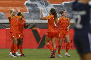 Houston Dash forward Rachel Daly (3) celebrates with teammates after scoring a goal against Sky Blue FC during an NWSL match at BBVA Stadium Sunday, July 28, 2019, in Houston.