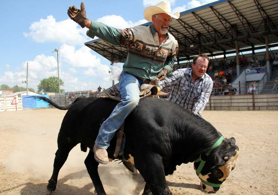 The Huron Community Fair kicks off with the Indian Trails Rodeo. The first horse show of the fair was also held this day. Photo: Andrew Mullin/Huron Daily Tribune
