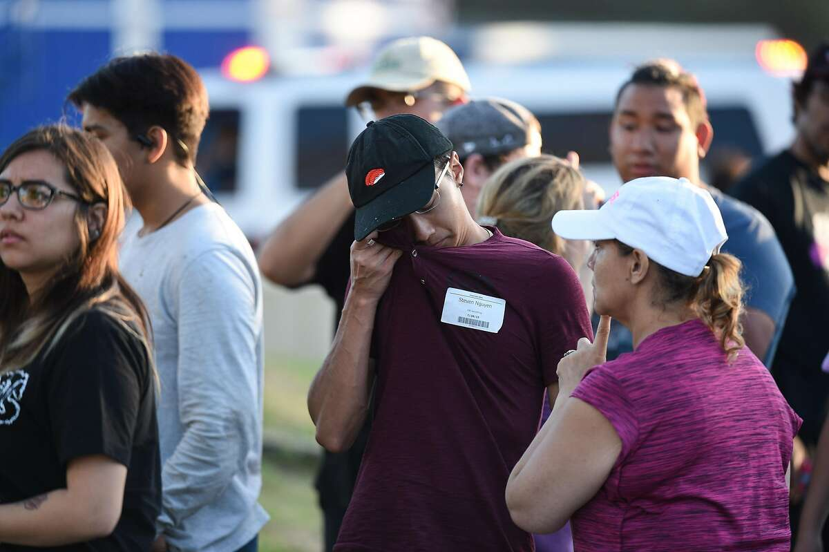 Steven Nguyen reacts at the scene of a shooting during the Gilroy Garlic Festival along Miller Avenue near Gilroy High School on July 28, 2019 in Gilroy, CA.