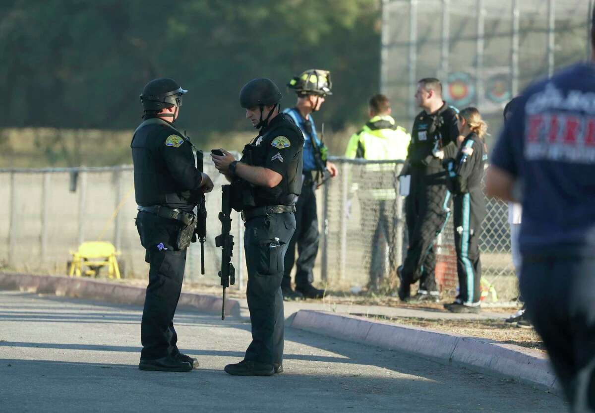 Emergency personnel stand outside Gilroy High School following a deadly shooting at the Gilroy Garlic Festival in Gilroy, Calif., on Sunday, July 28, 2019. (Nhat V. Meyer/San Jose Mercury News via AP)