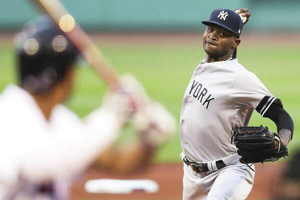 Domingo German of the Yankees pitches in the first inning against the Red Sox at Fenway Park on Sunday night in Boston.