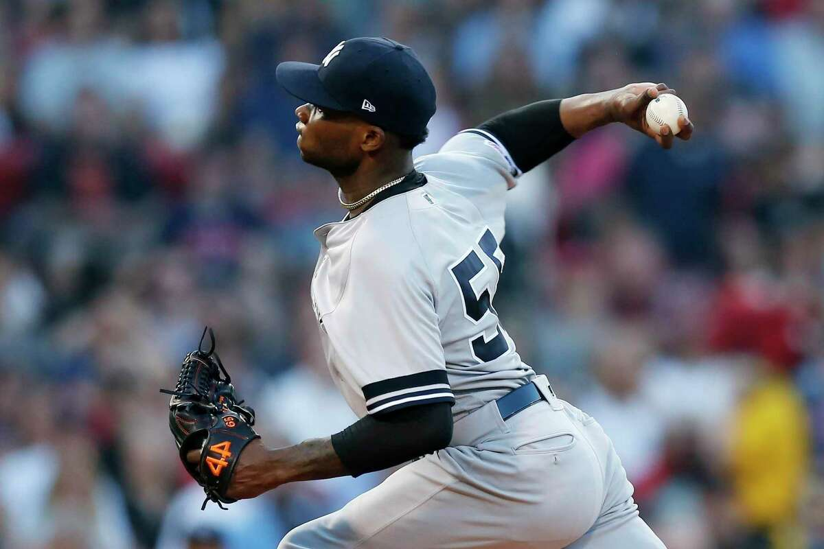 Domingo German of the Yankees pitches during the first inning against Red Sox in Boston on Sunday.