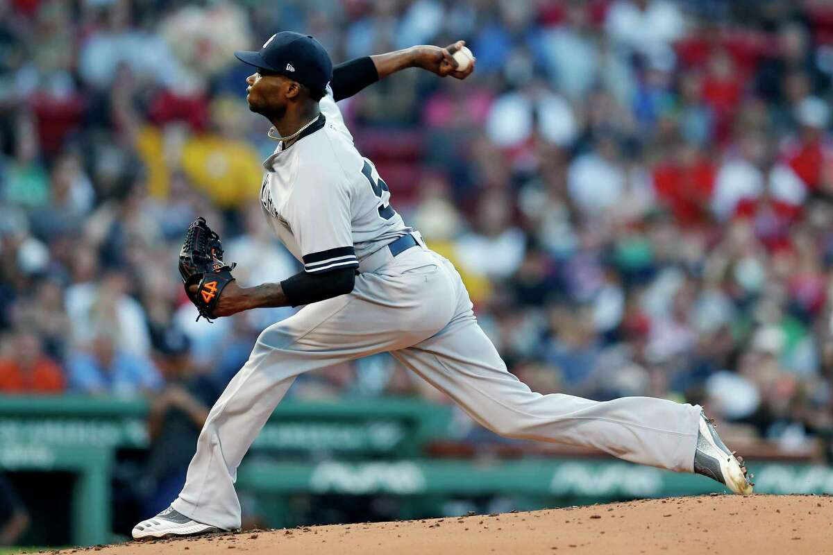 Yankees' starter Domingo German pitches during the first inning against the Red Sox in Boston on Sunday.