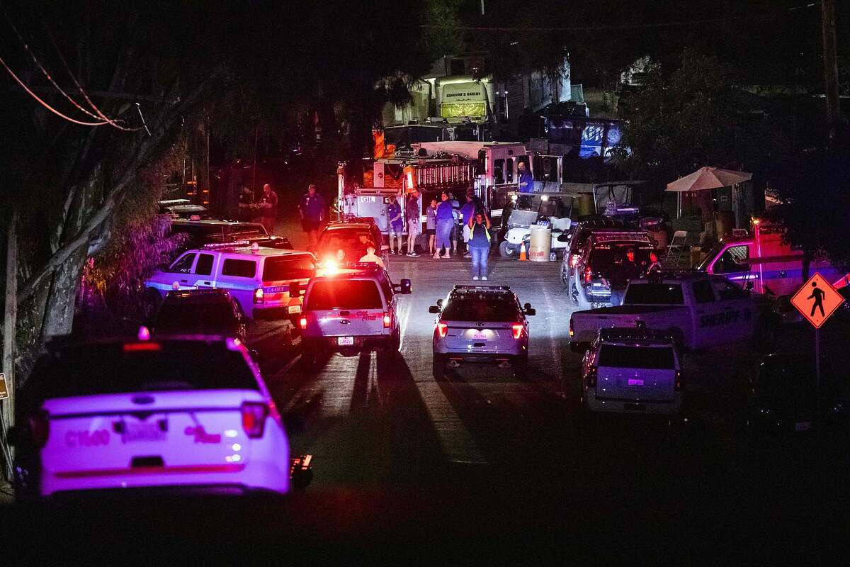 Police vehicles arrive on the scene of the investigation following a deadly shooting at the Gilroy Garlic Festival in Gilroy, 80 miles south of San Francisco, California on July 28, 2019. - Three people were killed and at least 15 others injured in a shooting at a major food festival in California on Sunday, police said. Officers confronted and shot dead the suspect
