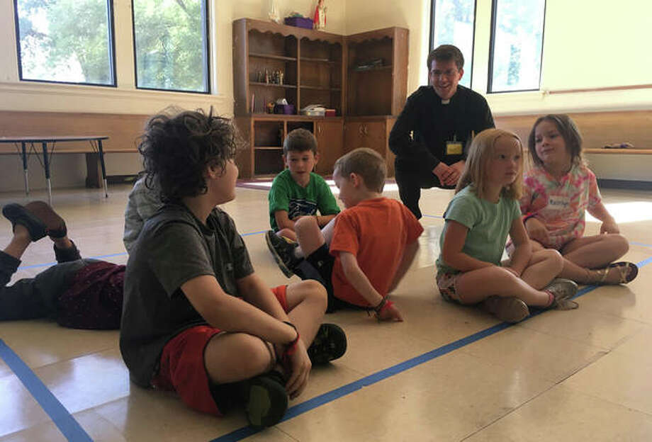 Grant Wilson, a Jacksonville native and seminarian of the Diocese of Springfield, interacts with campers Thursday during Totus Tuus Catholic Youth Summer Camp in Springfield. Photo: Rosalind Essig | Journal-Courier