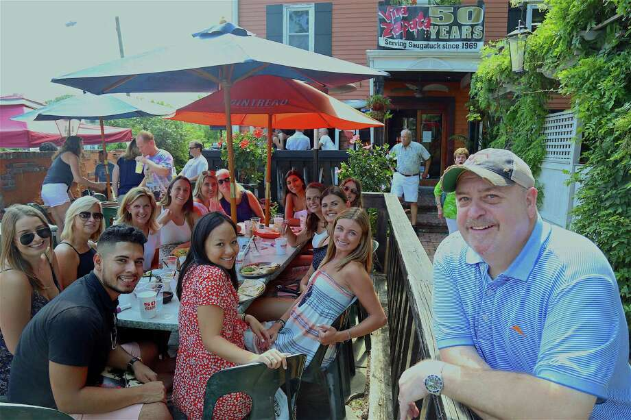 Co-owner Harry Brady, at right, poses with a large table of family and friends at the 50th anniversary celebration of Viva Zapata restaurant on Saturday, July 27, 2019, in Westport, Conn. Photo: Jarret Liotta / Jarret Liotta / ©Jarret Liotta
