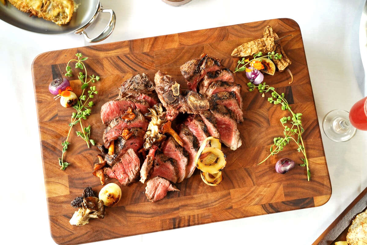 A 40-ounce Porterhouse for two served with Cipollini onions, maitake mushrooms and sauce Bearnaiseat the new David St. at Hermann Park under the direction of chef Mark Holley, opening fall 2019.