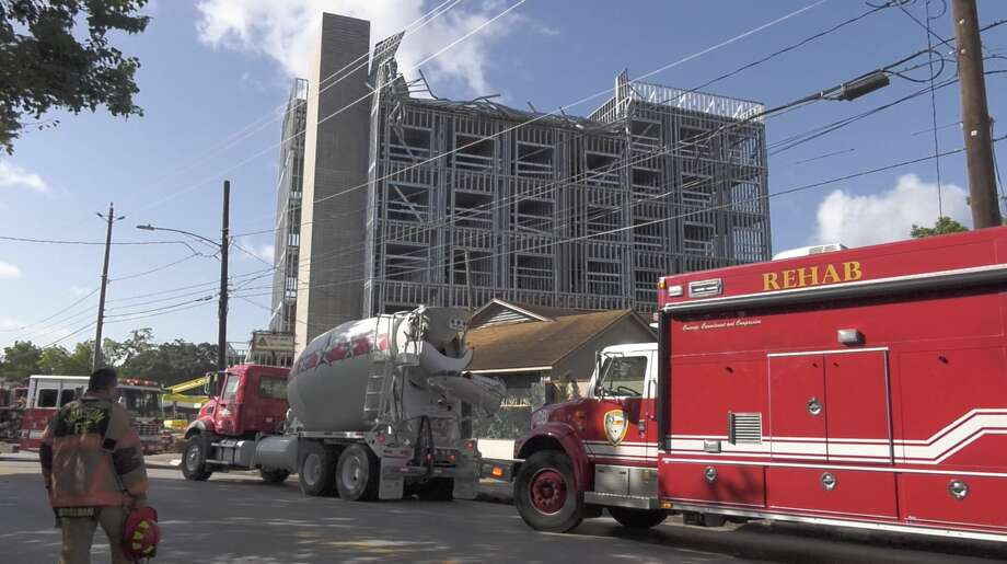 Houston firefighters work a scene where the top floor of a building under construction reportedly collapsed Monday, July 29, 2019. Photo: Jay R. Jordan / Houston Chronicle