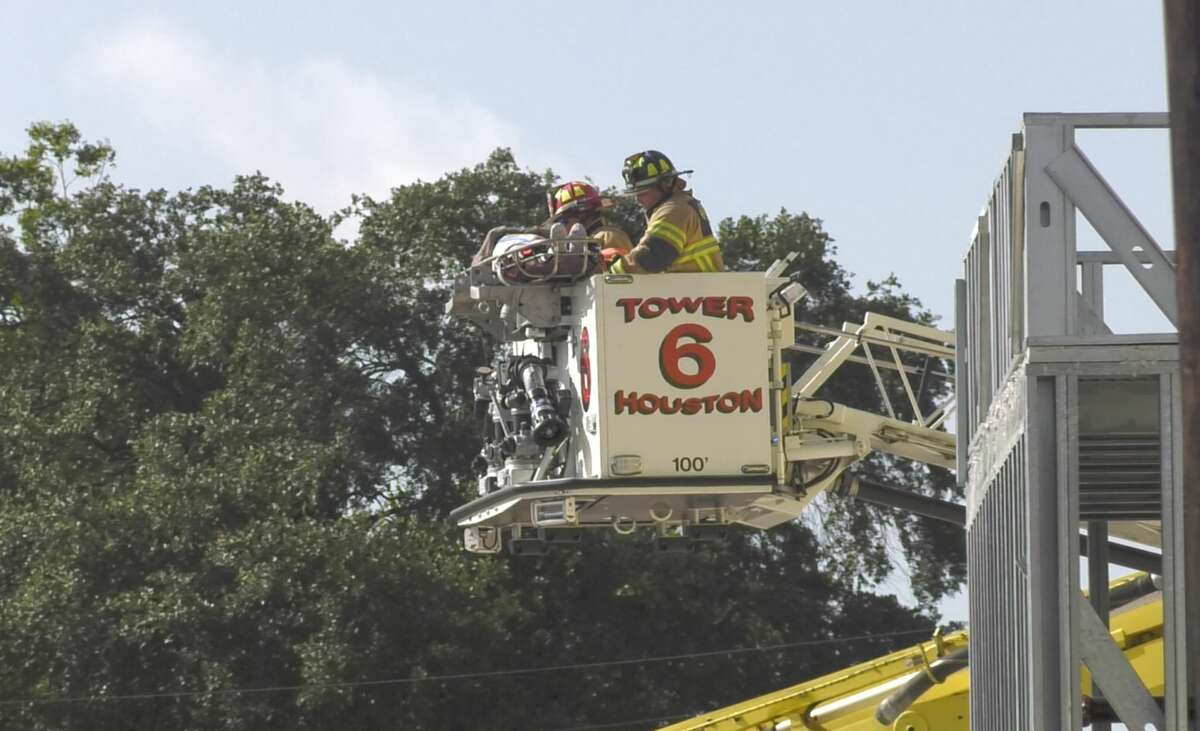 Houston firefighters work a scene where the top floor of a building under construction reportedly collapsed Monday, July 29, 2019.