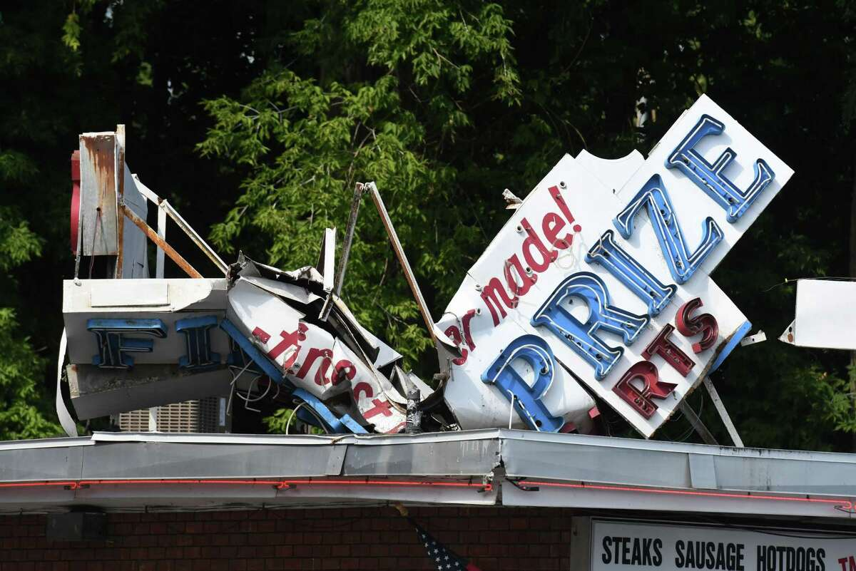 The sign atop Mike's Hot Dogs on Eire Blvd. was badly damaged following a weekend storm on Monday, July 29, 2019, in Schenectady, N.Y. (Will Waldron/Times Union)