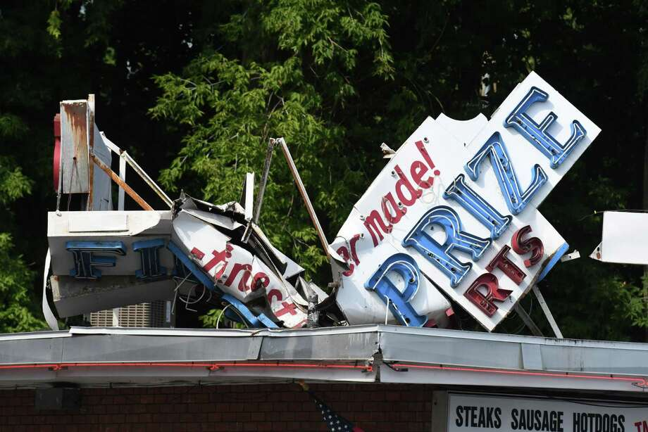 The sign atop Mike's Hot Dogs on Eire Blvd. was badly damaged following a weekend storm on Monday, July 29, 2019, in Schenectady, N.Y. (Will Waldron/Times Union) Photo: Will Waldron, Albany Times Union / 40047560A