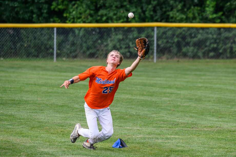 The Midland junior Little League team competes against Commerce Township during the state tournament on Sunday, July 28, 2019 in Grand Rapids. (Adam Ferman/for the Daily News) Photo: (Adam Ferman/for The Daily News)