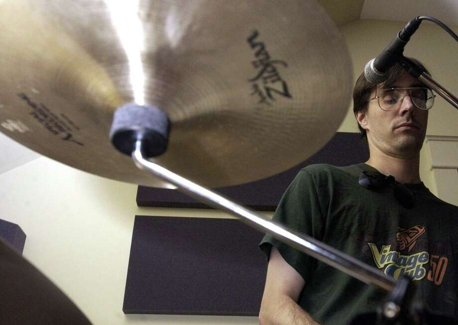 Chris Pike of Ridgefield plays drums during a practice. Pike, the owner of Ridgefield Music since the early 1990s, will be closing his Governor Street business on Wednesday, July 31.