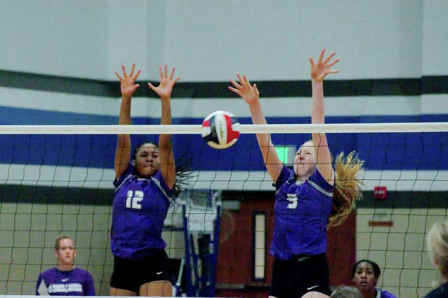 Ridge Point's Nia McCardell (12) and Ridge Point's Claire Jeter (9) put up a block at the net against Kingwood during the BSN/Under Armour CCISD Volleyball Tournament at Clear Springs High School on Sept. 1, 2018. Photo: Kirk Sides / Houston Chronicle / © 2016 Kirk Sides / Houston Community Newspapers