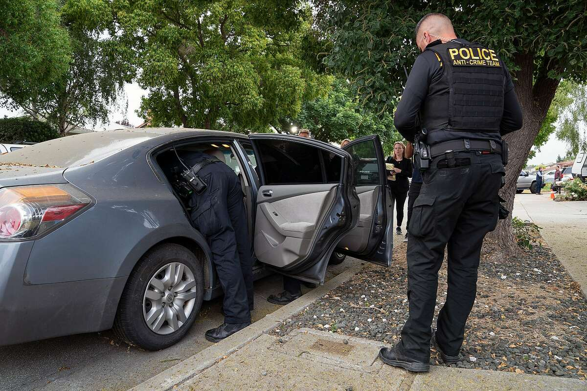 Gilroy Police Department officers search a gray Nissan Altima parked outside the Gilroy Garlic Festival shooting suspect Santino William Legan's family home in Gilroy, Calif., on Monday, July 29, 2019.