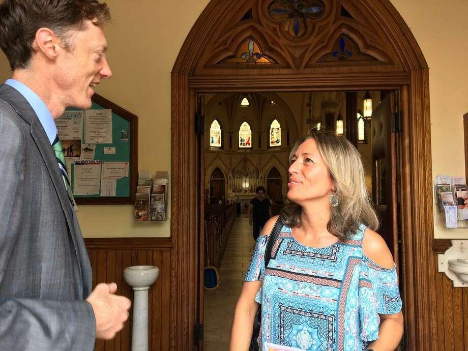 Justin Elicker with Gloria Vega at St. Francis Church Photo: Mary E. O'Leary / Hearst Connecticut Media