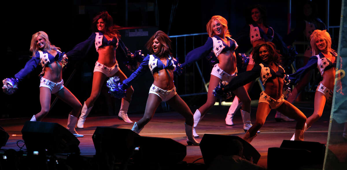 SPORTS The Dallas Cowboys Cheerleaders perform at the opening of training camp at the Alamodome in San Antonio on Tuesday, July 28, 2009. Tom Reel/Staff