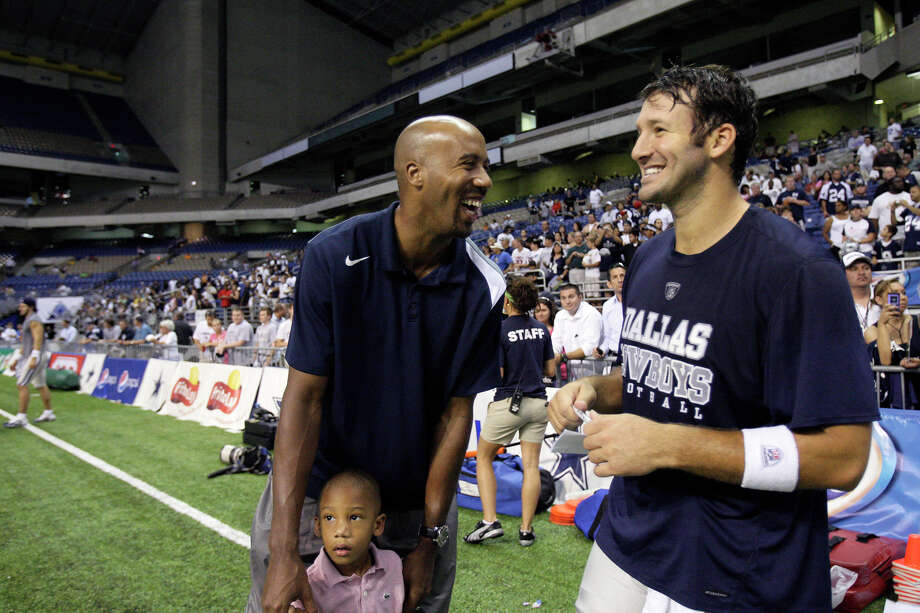 SPORTS -- Former San Antonio Spurs Bruce Bowen talks with Dallas Cowboys quarterback Tony Romo after practice at the Alamodome, Thursday, August 6, 2009. With Bowen is his son, Ojani, 3. JERRY LARA/glara@express-news.net Photo: JERRY LARA/San Antonio Express-News