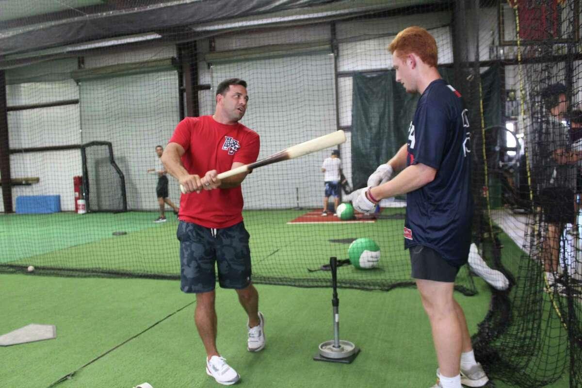 Co-owner Sean Danielson offers hitting advice to Cy-Fair rising senior Rhett McCaffety at the Hunter Pence Baseball Academy, Wednesday July 17, 2019, in Houston.