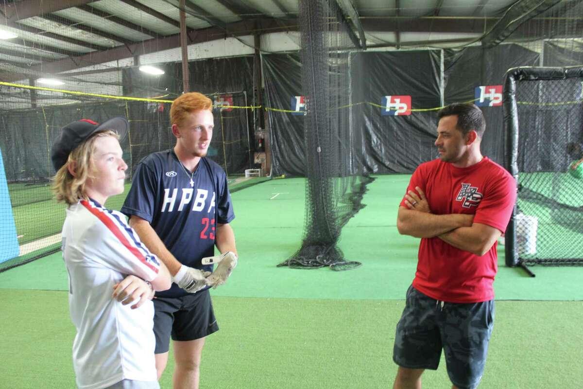 Co-owner Sean Danielson talks baseball with Cy-Fair rising senior Rhett McCaffety and rising eighth grader McClane Helton at the Hunter Pence Baseball Academy, Wednesday July 17, 2019, in Houston.