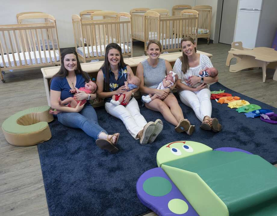 Trinity School employees, Jessica McMullen with her daughter Maren, Morgan Ramsey with her son August, Annie Rubalcava with her daughter Molly Claire and Paige Newton with her son Jack, in the new infant care room at Trinity School. 07/29/19  Tim Fischer/Reporter-Telegram Photo: Tim Fischer/Midland Reporter-Telegram