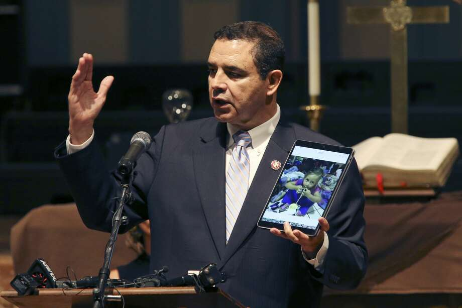 During a press conference at Travis Park Methodist Church on Monday, July 22, 2019, U.S. Congressman Henry Cuellar shows a photograph of a migrant child he met at the bus station in Laredo. Cuellar was joined by local and city officials along with nonprofit representative in announcing nearly $30 million in reimbursement for expenses used in the migrant crisis. Photo: Jerry Lara/Staff Photographer