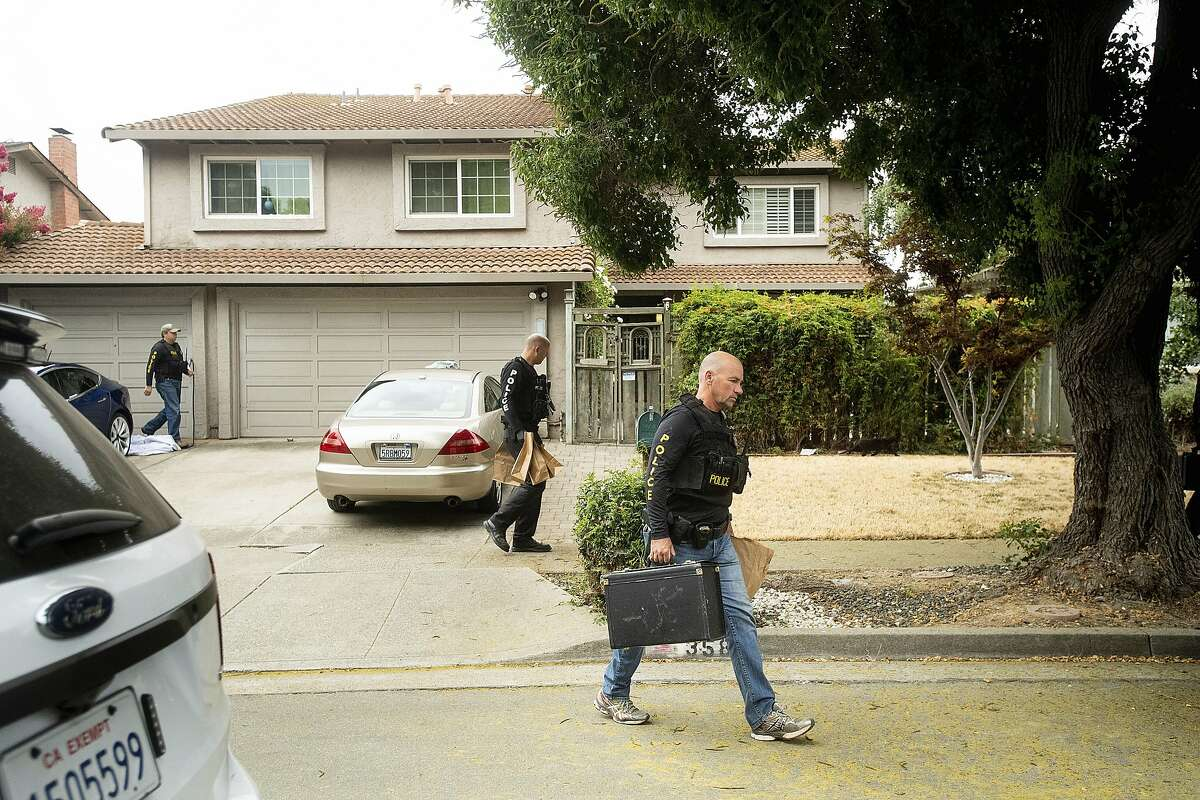 Police officers carry evidence bags from the family home of Gilroy Garlic Festival gunman Santino William Legan, Monday, July, 29, 2019, in Gilroy, Calif. The Sunday evening shooting left at least three people, including a 6-year-old boy, dead and wounding about 15 others. (AP Photo/Noah Berger)