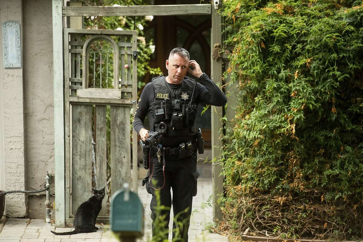 A police officer leaves the family home of Gilroy Garlic Festival gunman Santino William Legan on Monday, July, 29, 2019, in Gilroy, Calif. The Sunday evening shooting left at least three people, including a 6-year-old boy, dead and wounding about 15 others. (AP Photo/Noah Berger)