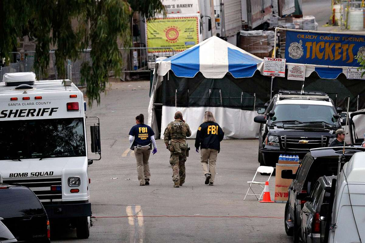 Local and federal police continue the the investigation at Christmas Hill Park in Gilroy, Calif., on Monday, July 29, 2019, the day after a gunman opened fire as the Gilroy Garlic Festival was ending killing three. The gunman was shot and killed by police on the scene.