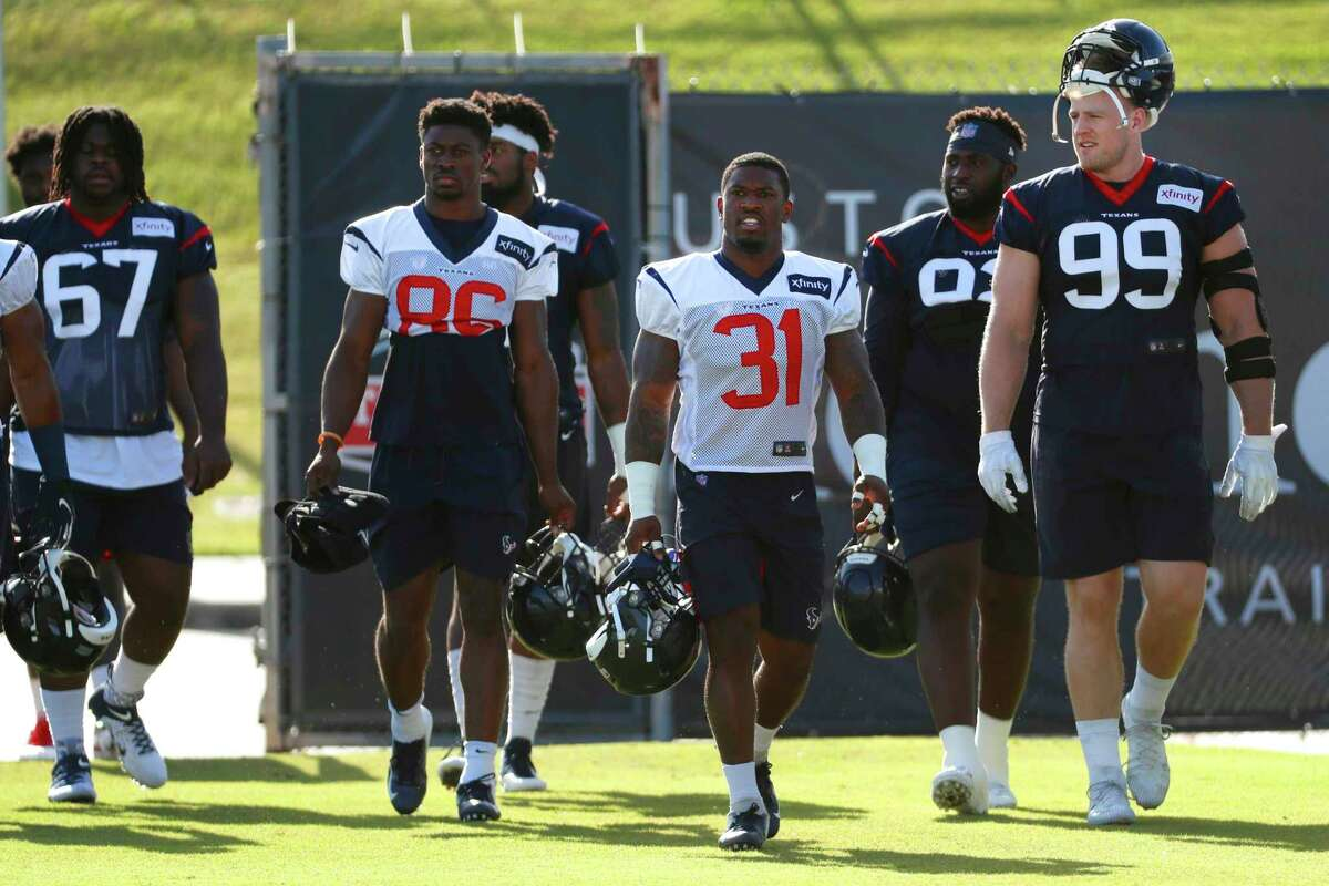 Houston Texans players walk onto the practice field during training camp at the Methodist Training Center on Monday, July 29, 2019, in Houston.