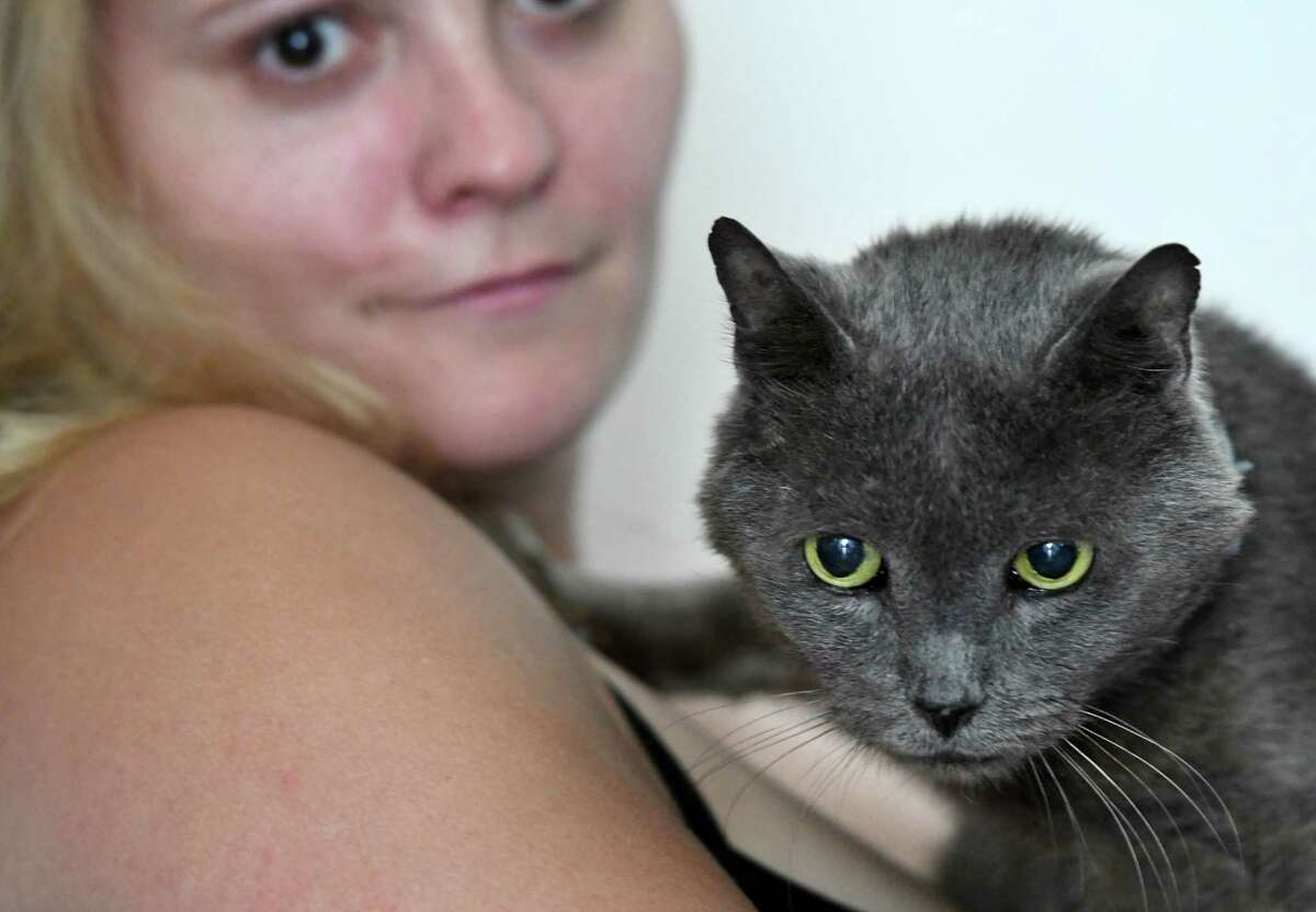 Cassandra Pearsall holds Mario, her pet cat who was missing for four years before being recently located in Cohoes on Monday, July 29, 2019, in Corinth, N.Y. (Will Waldron/Times Union)