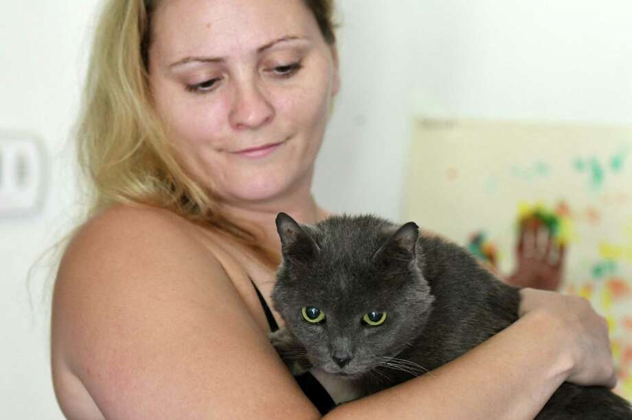 Cassandra Pearsall holds Mario, her pet cat who was missing for four years before being recently located in Cohoes on Monday, July 29, 2019, in Corinth, N.Y.  (Will Waldron/Times Union) Photo: Will Waldron, Albany Times Union / 40047562A