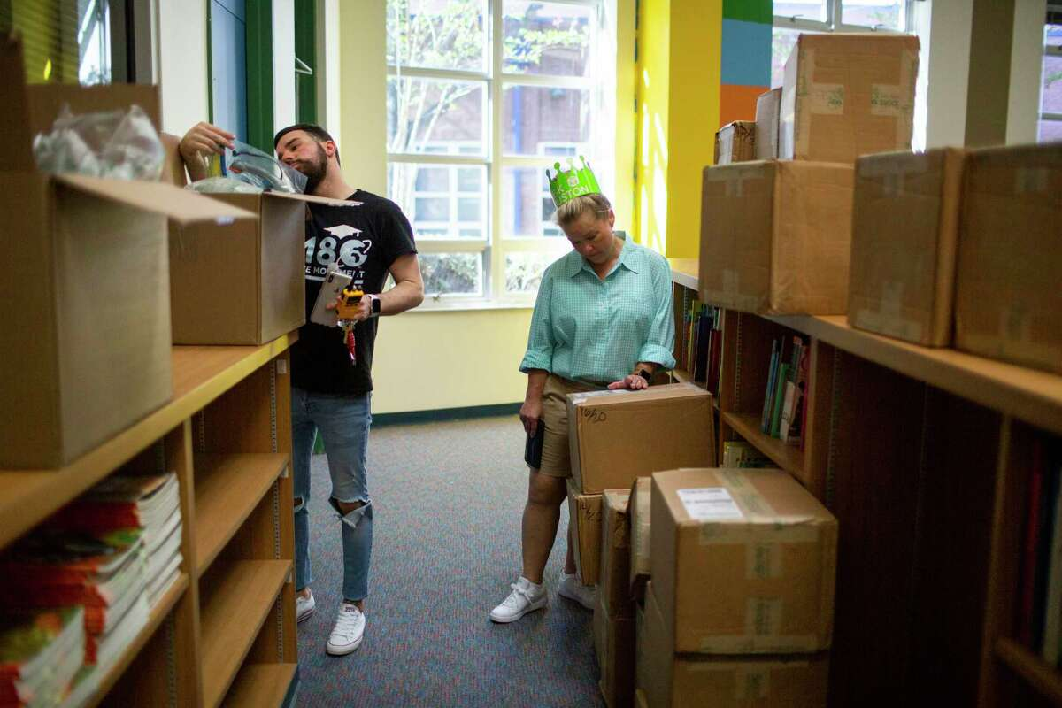 Wesley Elementary School principal TJ Cotter, left, and Mechiel Rozas, director of early childhood at Houston ISD go over the new supply of books during a tour of the school on Saturday, July 27, 2019, in Houston. Wesley Elementary School, which is one of 12 Houston ISD campuses expanding its number of pre-K seats available in 2019-2020.