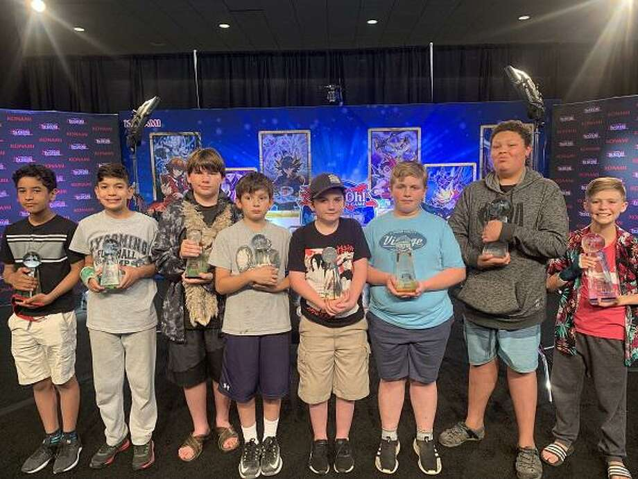 The top eight finalists at the Yu-Gi-Oh World Championship qualifier earlier this summer were, from left to right: Lucas Oswald, Jacob Elson, DaVinci Sukienik, Colin McIntee, Jack Winstanley, Jason James, Giovanni White, and Wael Hamid. Winstanley is from Ridgefield. Photo: Contributed Photo