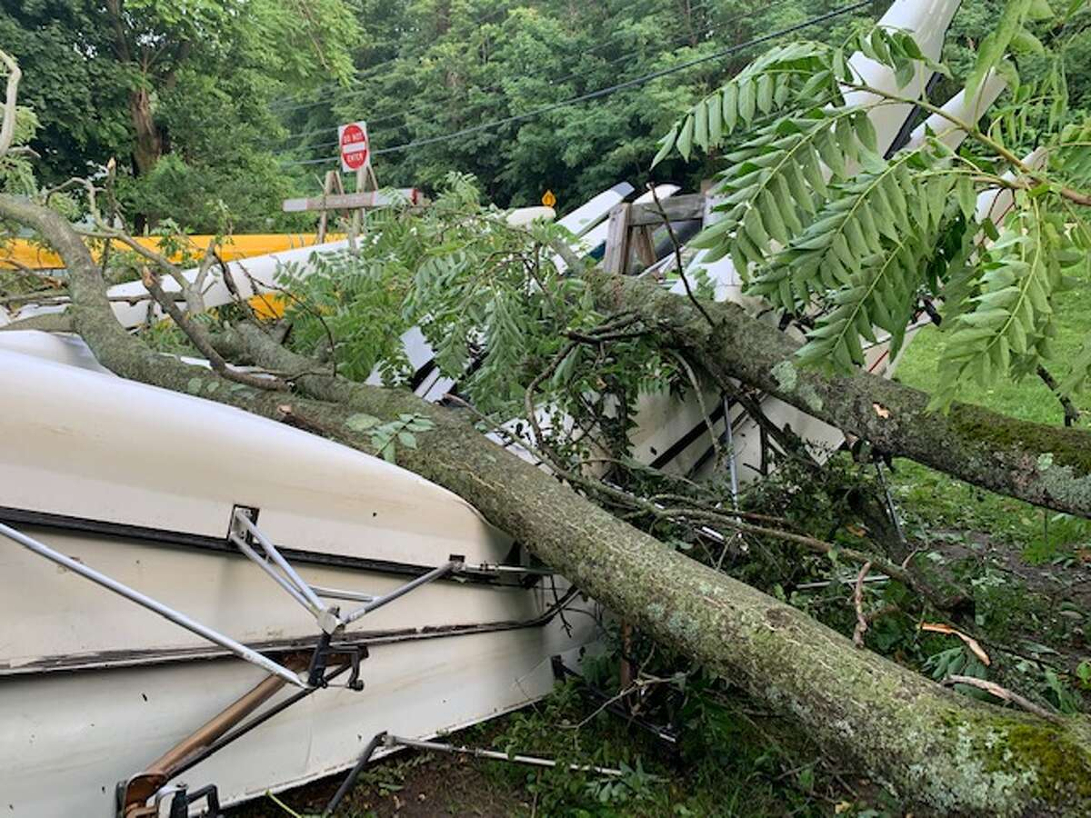 A tree toppled by a severe thunderstorm crushed a boat rack and destroyed seven boats - the entire middle school fleet - at Niskayuna Rowing on Sunday, July 28, 2019 in Niskayuna, N.Y.