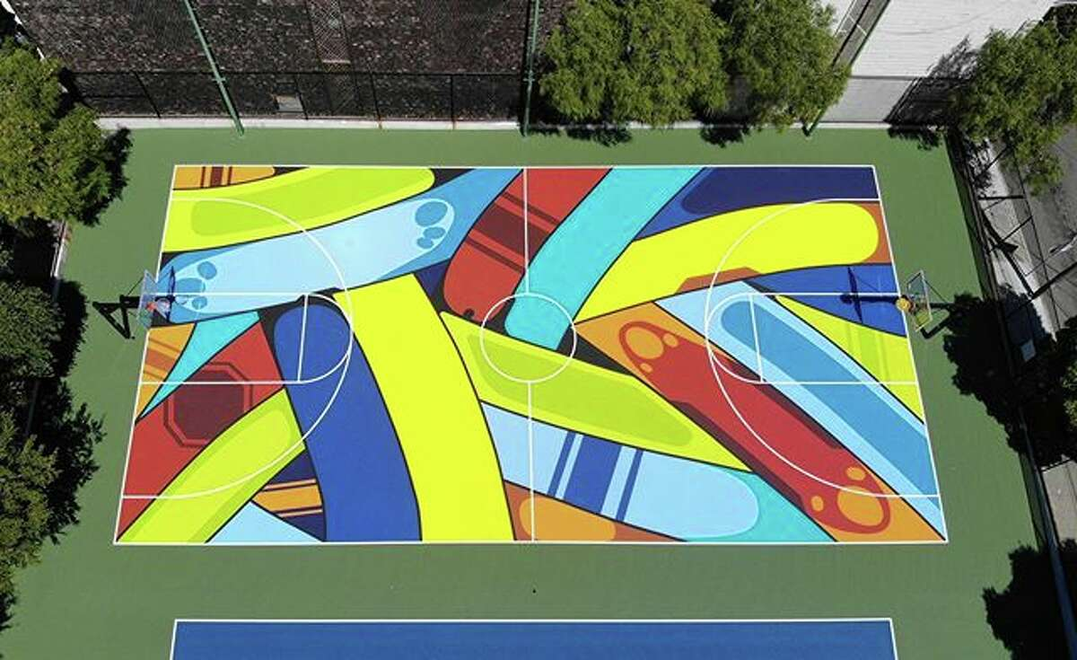 The surface for the renovated basketball court at the Hayes Valley Playground in San Francisco is a work of art designed by local artist Apexer. The project was partly funded by the Kevin Durant Charity Foundation, with the work done by Vintage Contractors.