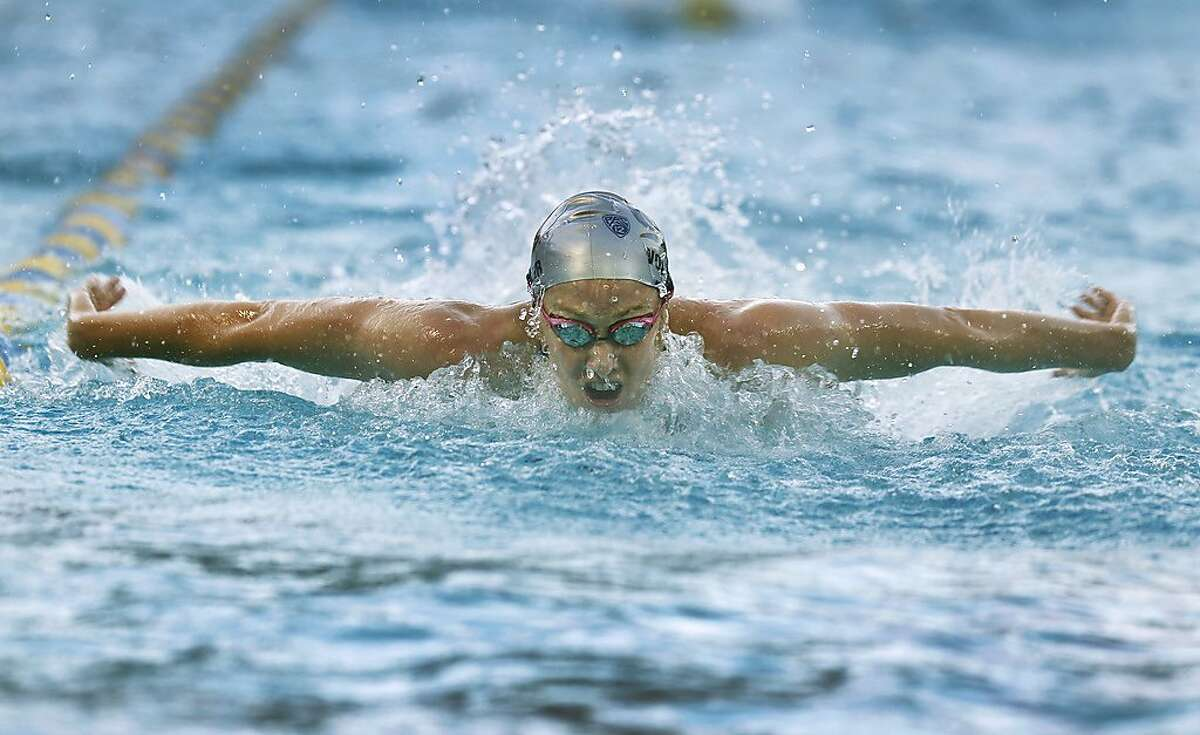 Olympic gold medalist and former Cal swimmer Dana Vollmer trains with the current Bears swim team at UC Berkeley on Friday, Dec. 18, 2015.