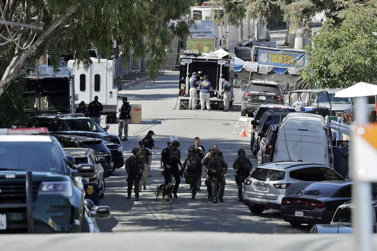 Local and federal police continue the investigation at Christmas Hill Park in Gilroy, Calif., on Monday, July 29, 2019, the day after a gunman opened fire as the Gilroy Garlic Festival was ending, killing three.