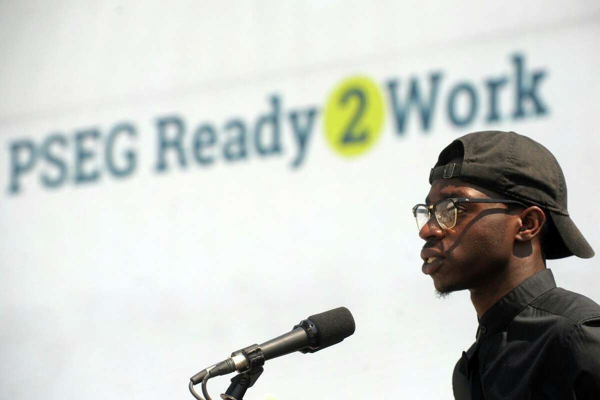 Tavon Walker, an apprentice electrician from Bridgeport, speaks during the grand opening ceremony for PSEG's Bridgeport Harbor Station Unit #5, the new natural gas-fired power plant now online in Bridgeport, Conn., July 29, 2019. Walker was in during PSEG's Ready 2 Work program and worked the power plant's construction.