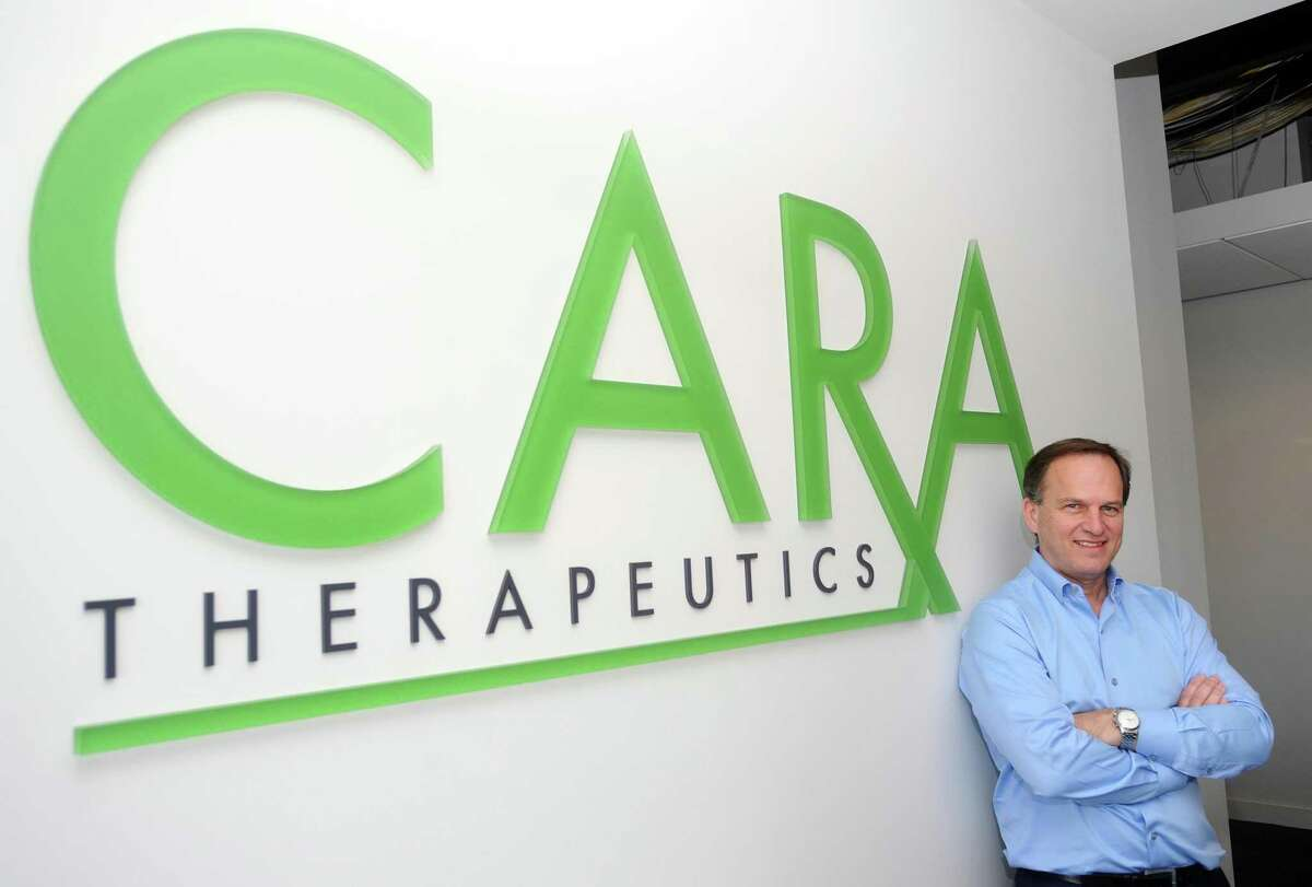 Cara Therapeutics CEO Derek Chalmers poses for a photo inside the firm's offices at 107 Elm St., in Stamford, Conn. Cara held its initial public offering in 2014.