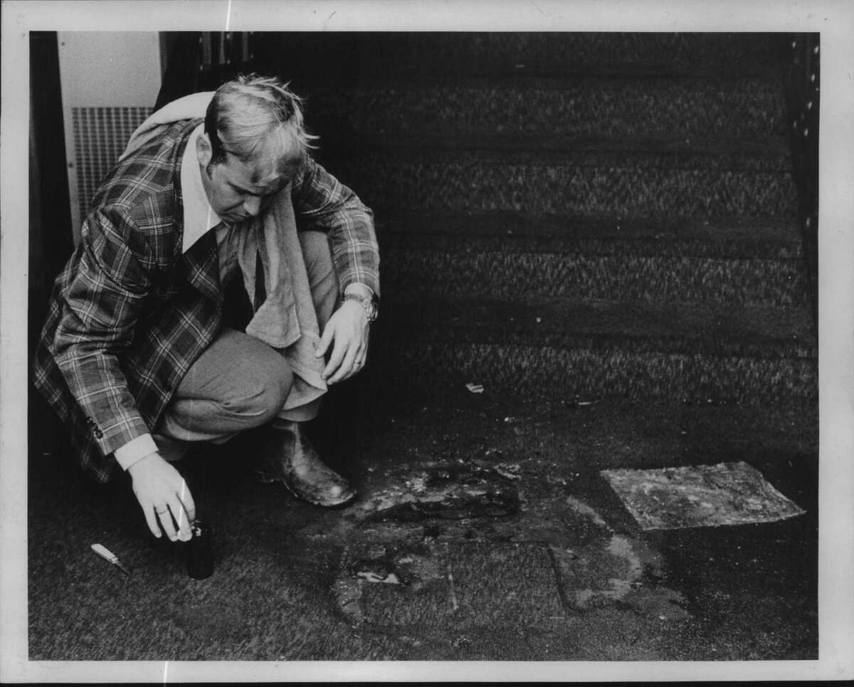 Detective Douglas Mayville on the job outside the Metropolitan New Testament Mission Baptist Church in Albany in September 1978. (Bob Richey/Times Union Archive)
