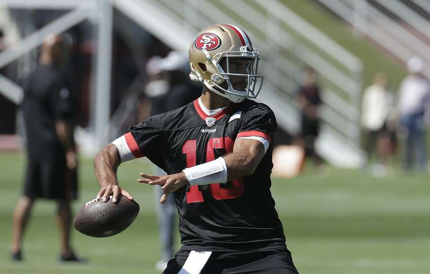 San Francisco 49ers quarterback Jimmy Garoppolo throws a pass at the team's NFL football training camp in Santa Clara, Calif., Saturday, July 27, 2019. (AP Photo/Jeff Chiu)