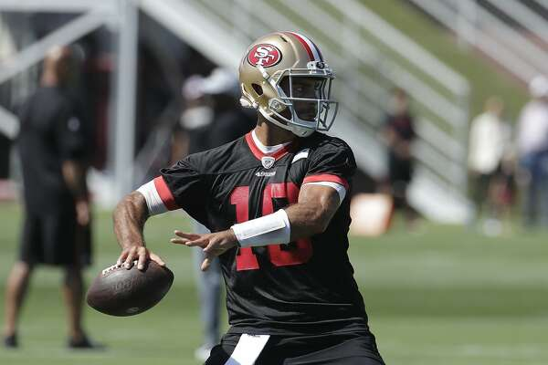 San Francisco 49ers quarterback Jimmy Garoppolo throws a pass at the team's NFL football training camp in Santa Clara, Calif., Saturday, July 27, 2019. (AP Photo/Jeff Chiu)