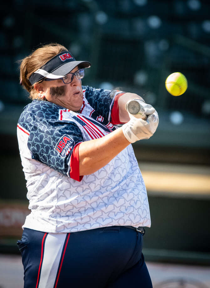 Team USA's Christan Dowling hits one of her two homers during Saturday's Border Battle women's game vs. Canada at Dow Diamond. Photo: Steve Simpkins For The Daily News