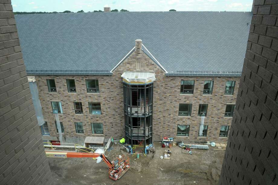 Four new residence halls are under construction on the Upper Quad of Sacred Heart University, in Fairfield, Conn., July 24, 2019. Photo: Ned Gerard / Hearst Connecticut Media / Connecticut Post