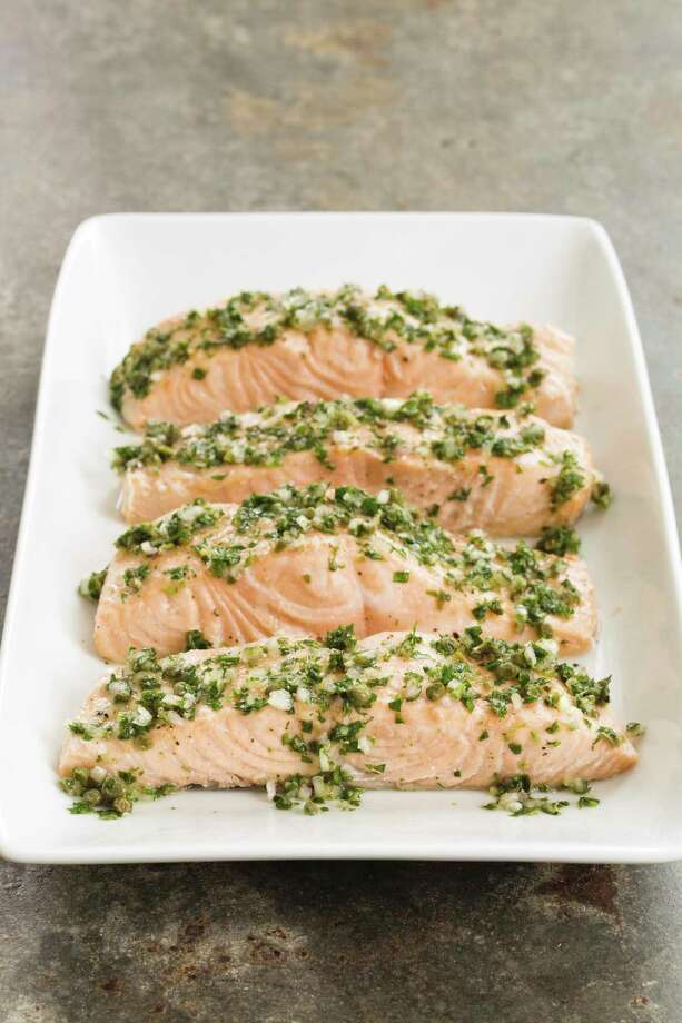 """This undated photo provided by America's Test Kitchen in July 2019 shows Poached Salmon with Herb and Caper Vinaigrette in Brookline, Mass. This recipe appears in """"The Complete Diabetes Cookbook."""" (Daniel J. van Ackere/America's Test Kitchen via AP) Photo: Daniel J. Van Ackere / Daniel J. Van Ackere/America's Test Kitchen / ©2014, Boston Common Press, DBA America's Test Kitchen. All Rights Reserved."""
