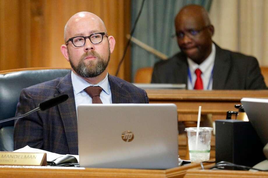 Supervisor Rafael Mandelman listens during a board meeting in San Francisco. Photo: Santiago Mejia / The Chronicle