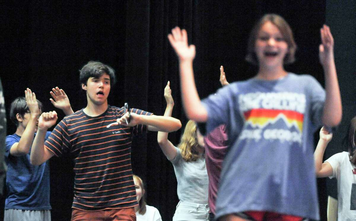 Oliver White, center, along with other cast members perform a dance routine during the Off Beat Players rehearsal for Joseph and the Amazing Technicolor Dreamcoat on July 19, 2019 at the Performing Arts Center of Greenwich Country Day School in Greenwich, Connecticut. Off-Beat Players, is a Greenwich-based nonprofit theater company, that provides young adults with disabilities the opportunity to participate in a performing arts program. The company performs fully staged musicals with a live orchestra each summer.