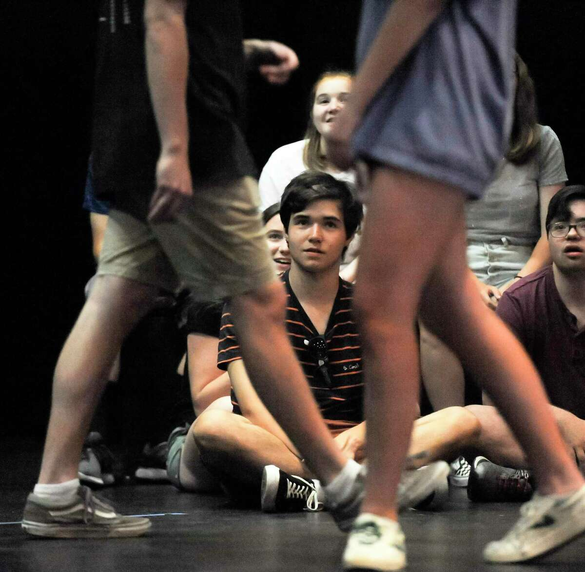 Oliver White, center, watches as cast members perform a dance routine during the Off Beat Players rehearsal for Joseph and the Amazing Technicolor Dreamcoat on July 19, 2019 at the Performing Arts Center of Greenwich Country Day School in Greenwich, Connecticut. Off-Beat Players, is a Greenwich-based nonprofit theater company, that provides young adults with disabilities the opportunity to participate in a performing arts program. The company performs fully staged musicals with a live orchestra each summer.